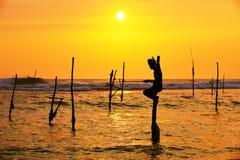 Stilt fishing Stock Photo
