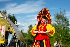 Stilt on the holiday and happy people. Tyumen, Russia - June 15, 2019: Ethnofest `Heaven and Earth` - Annual All-Russian Cultural and Developing Ethno-Festival stock images