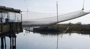 Stilt house and fishing nets along the Po Delta Royalty Free Stock Photo