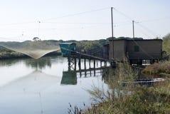 Stilt house and fishing nets along the Po Delta Stock Image