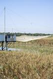 Stilt house and fishing nets along the Po Delta Stock Photo