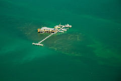 Stilt house and pier in the ocean Stock Photo