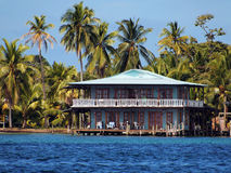 Stilt house and sea Stock Images