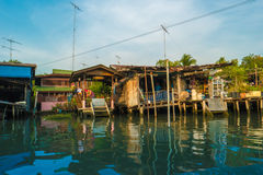 Stilt houses above river in rural Thailand. Royalty Free Stock Image