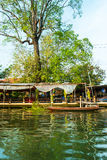 Stilt houses above river in rural Thailand. Royalty Free Stock Photo