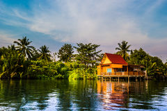 Stilt houses above river in rural Thailand. Royalty Free Stock Images