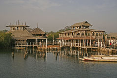 Stilt houses in Africa stock images