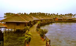 Stilt houses on lake. Scenic view of stilt houses and raised walkway on lake Royalty Free Stock Photography