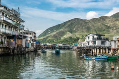 Stilt houses Tai O Lantau island Hong Kong. Tai O, Hong Kong, China- June 10, 2014: stilt houses and fishermen motorboats in Lantau island Royalty Free Stock Photography