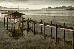 Stilt hut in a lake Stock Image