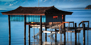 Stilt hut in a lake Royalty Free Stock Image
