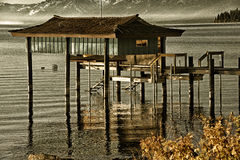 Stilt hut in a lake Stock Photo