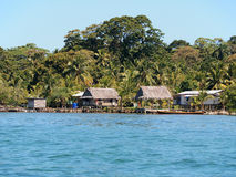 Stilt hut with thatched roof on the beach Royalty Free Stock Photo