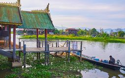 The stilt porch of old monastery, Inle Lake, Myanmar. YWAMA, MYANMAR - FEBRUARY 18, 2018: The beautiful stilt porch of Nga Phe Chaung Monastery of jumping cats Stock Photos