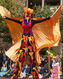 Stilt Walker In Bird Costume Royalty Free Stock Photos