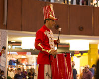 Stilt Walkers Band Drummer. A Stilt walker band drummer, Stilt walking is walking on long sticks , Stilts are used widely in many countries for the purpose of Stock Image