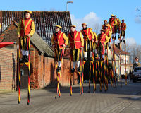 Stilt Walkers on Parade. AALST, BELGIUM JANUARY 17 2016: The Delegation of Royal Stiltwalkers during the St. Anthony's parade in Herdersem near Aalst. It is a Stock Photos