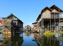 Stilted houses in village on Inle lake Stock Photos