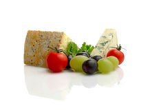Stilton Blue Cheese. Studio macro of fresh Blue Stilton cheese with grapes and cherry tomatoes on a white background with soft shadows. Copy space stock photo