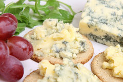 Stilton Cheese & Biscuits. Mature Stilton cheese with rough oatcake biscuits and grapes Royalty Free Stock Photo