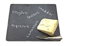 Stilton cheese on slate cheeseboard Royalty Free Stock Images