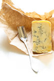 Stilton cheese on a white background. Stock Photography