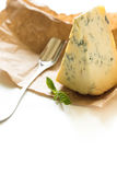 Stilton cheese on a white background. Stock Images