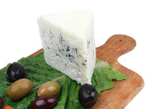 Stilton cheese on wood Royalty Free Stock Images