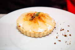 Stilton tart with caramelized pears Stock Image