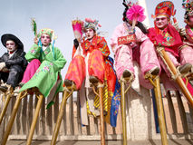 Stilts actor sitting baluster rest Stock Photography