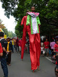 Stilts. People using stilts while attending a cultural parade in the city of Solo, Central Java, Indonesia Royalty Free Stock Image