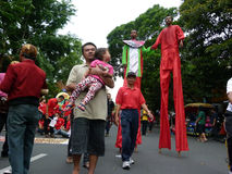 Stilts. People using stilts while attending a cultural parade in the city of Solo, Central Java, Indonesia Royalty Free Stock Photos