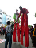 Stilts. People using stilts while attending a cultural parade in the city of Solo, Central Java, Indonesia Stock Photo
