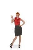 Stilvolle Frau, die auf leeres copyspace zeigt Lizenzfreies Stockbild