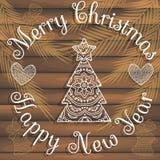 Stilvolle Karte für Glückwünsche auf Weihnachten und neuem Jahr Auf hölzerner Beschaffenheit Stockfoto
