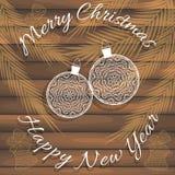 Stilvolle Karte für Glückwünsche auf Weihnachten und neuem Jahr Auf hölzerner Beschaffenheit Stockfotografie