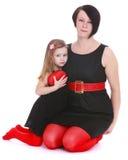 Stilvolle Mutter und Tochter in den schönen Kostümen lizenzfreie stockbilder