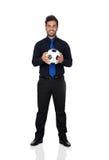 Stilvoller Fußballspieler mit einem Ball Stockfotos