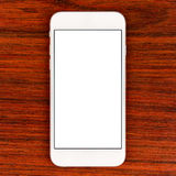Stilvoller weißer Smartphone über Tabelle Lizenzfreie Stockfotografie