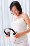 Stimulating the fetus using music Stock Image