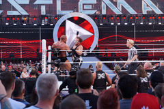 Sting clotheslines Triple H in corner of ring during match Royalty Free Stock Photography
