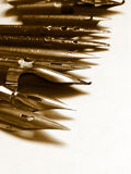 Stinging nostalgia. Old nibs aligned diagonally Stock Photo