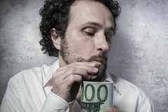 Stingy businessman, saving money, man in white shirt with funny Royalty Free Stock Photo