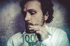 Stingy businessman, saving money, man in white shirt with funny Stock Photo