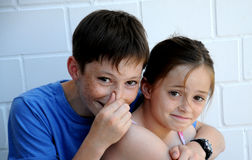 It stinks. Siblings in harmony It stinks, the boy keeps his nose stock images