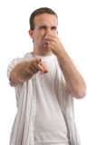 Stinky. A young man holding his nose because of a bad smell, isolated against a white background stock photos