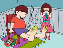 Stinky Feet. Little girl is disgusted by her brother's smelly feet Stock Image