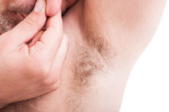 Stinky man underarm or armpit. As excessive sweat problem on white background royalty free stock photo