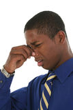 Stinky Smell. Young professional African American man holding nose and making stinky smell face Stock Photo