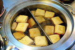 Stinky Tofu (Chou Tofu). A local must try dishes in a night market Taiwan. Stinky tofu (chou tofu) made from fermented bean curd serve with spicy sauce and stock photo